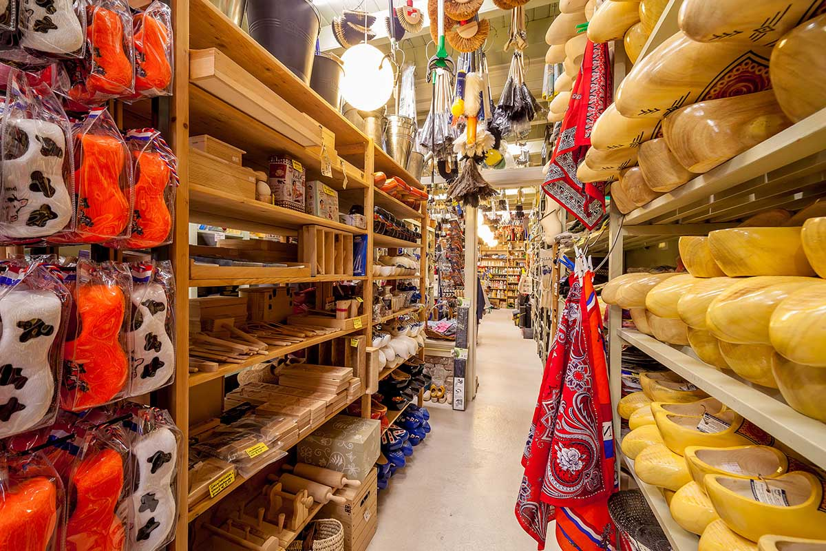 Large rows of traditional clogs, hundreds types of brushes and wooden utensils